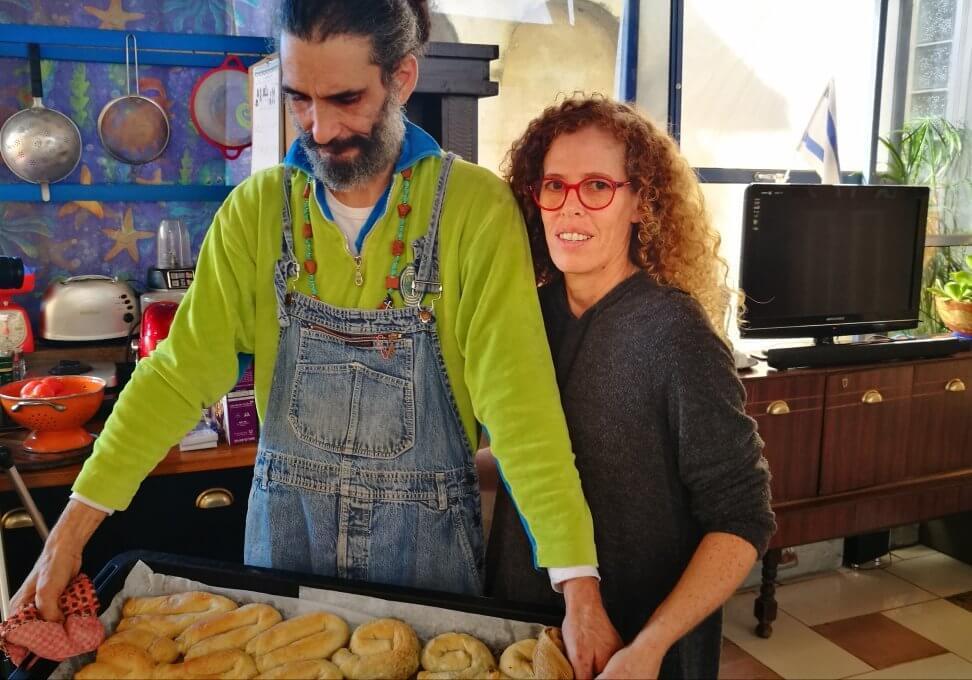 Sharon and Shlomo holding a full tray of freshly naked Bulemas